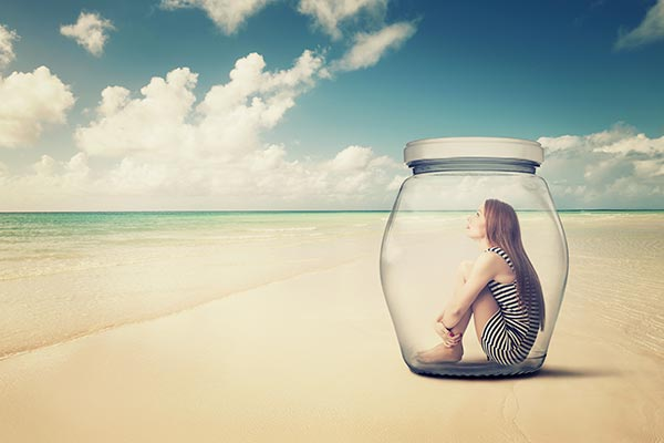 Woman in a Glass Jar on a Beach